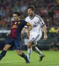 Xavi del Barça, en un partido contra el Real Madrid de 2012 (Foto FCB)